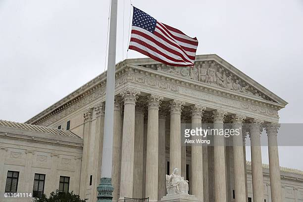 S flag flies at halfstaff outside the US Supreme Court on September 30 2016 in Washington DC The Supreme Court will return for a new term on Monday...