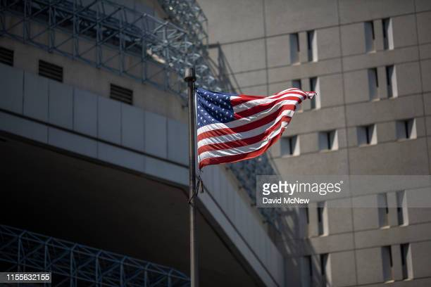 A flag flies at the Metropolitan Detention Center prison as mass arrests by federal immigration authorities as ordered by the Trump administration...