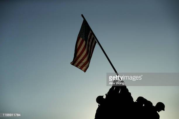 S flag flies at the US Marine Corps War Memorial on Flag Day June 14 2019 in Arlington Virginia The nation observes the Flag Day that commemorates...
