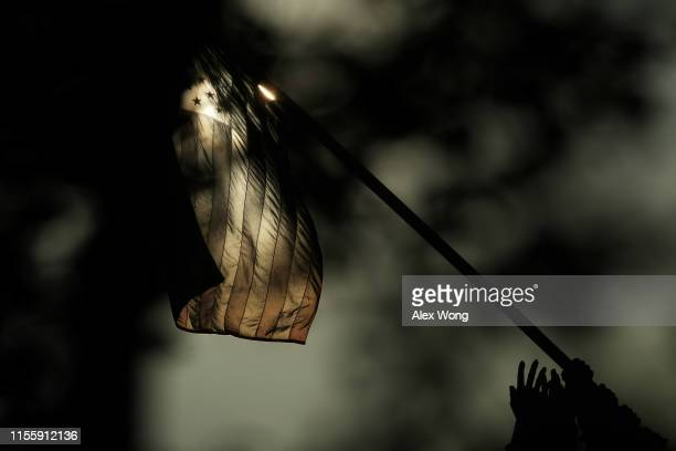 S flag flies at the US Marine Corps War Memorial on Flag Day June 14 2019 in Arlington VA The nation observes the Flag Day that commemorates the...