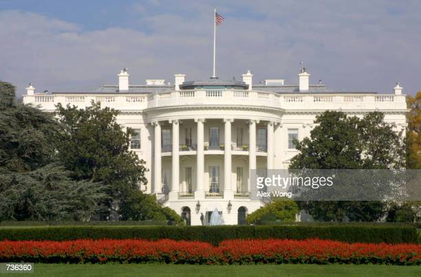 A flag flies atop the White House November 15 2000 in Washington DC as the United States awaits a decision in the presidential elections which have...