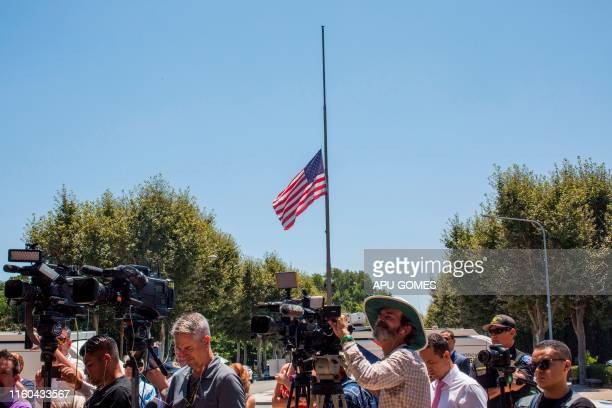 A US flag flies halfmast in honor of the victims of the El Paso and Dayton shootings during a press conference on August 8 2019 in front of the...