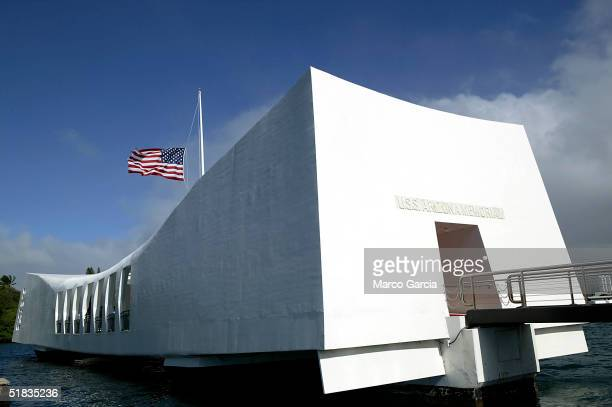 Flag flies half-mast over the USS Arizona Memorial December 7, 2004 in Pearl Harbor, Hawaii. Today marks the 63rd anniversary of the Japanese sneak...