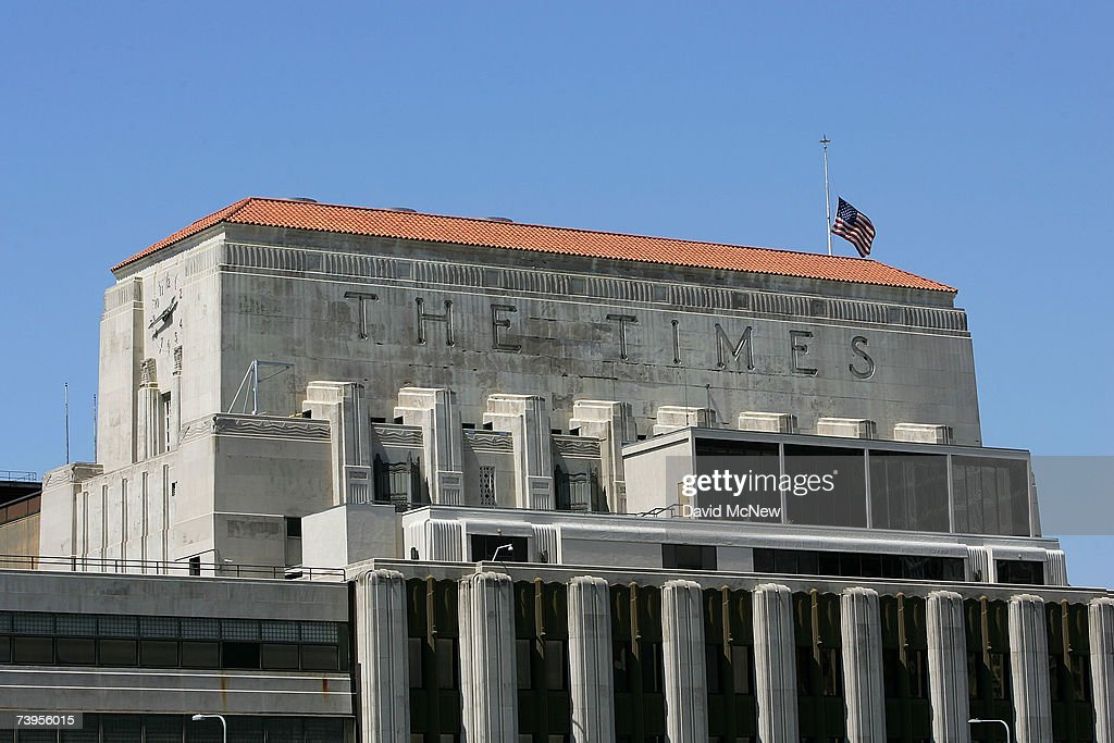 A flag flies half-staff on top of the Los Angeles Times building April 23, 2007 in Los Angeles, California. The Times announced today that it will offer voluntary buyouts in an effort to cut its staff of 2,625 by up to 150. Up to about 70 of those jobs would be in the newsroom, dropping the news staff to about 850. When the Tribune Co. bought the newspaper in 2000, there were 1,200 employed on the news side. Last fall, publisher Jeffrey M. Johnson and then Editor Dean Baquet were forced from the paper for fighting against cuts in the newsroom and arguing that a reduction of reporters and editors would hurt the quality of the paper, a belief contrary to that of Tribune executives.