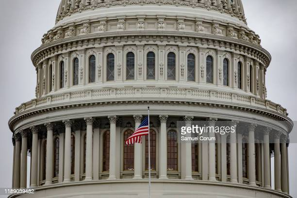 S flag flies in front of the US Capitol dome on December 16 2019 in Washington DC Washington is preparing for the House of Representatives to hold...