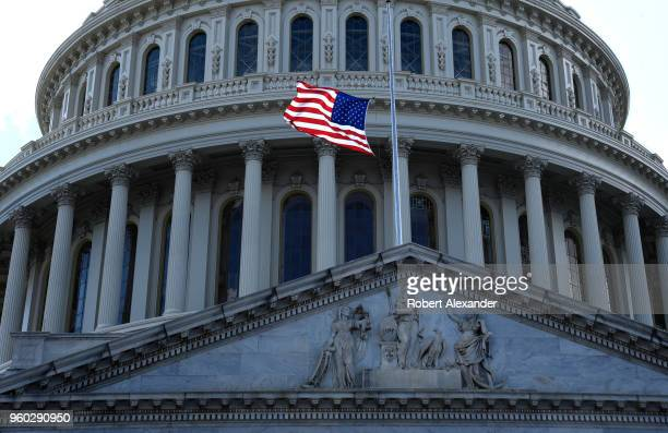 S flag flies in front of the US Capitol in Washington DC The flag flies at halfmast in honor of former First Lady Barbara Bush who died days earlier
