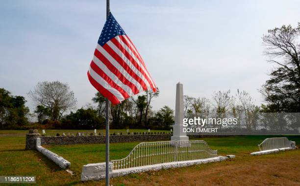 A US flag flies near a monument to early veterans buried in the Potter's field at Hart Island October 25 in New York Elaine Joseph's baby daughter is...