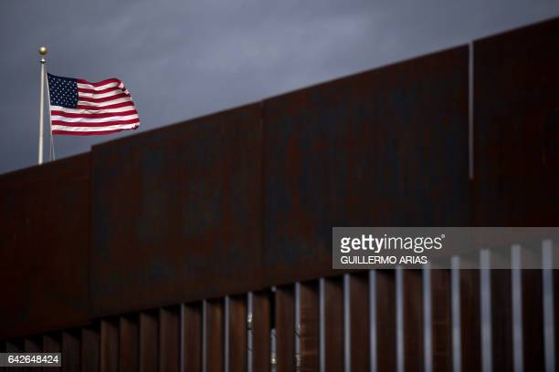 A US flag flies near section of the border fence on the US/Mexico border in Agua Prieta Sonora on February 18 northwestern Mexico Attention Editors...