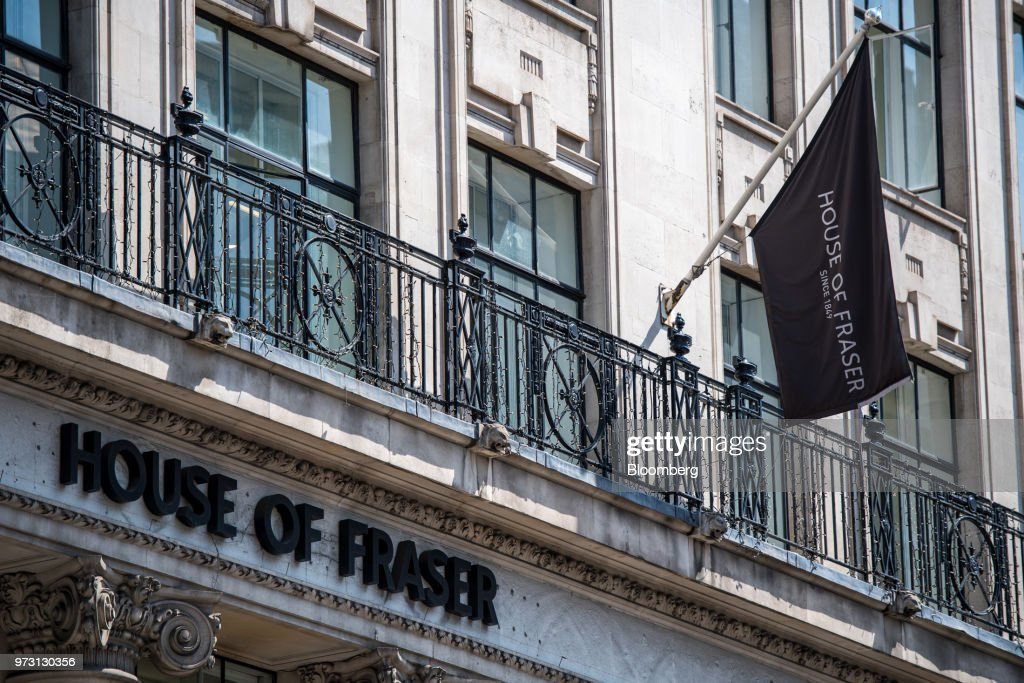 A flag flies on the outside of a House of Fraser store, one of the stores slated to be closed, on King William Street, in the City of London in London, U.K., on Wednesday, June 13, 2018. U.K. department-store chain House of Fraser said it plans to shut more than half its outlets, putting 6,000 jobs at risk. Photographer: Chris J. Ratcliffe/Bloomberg via Getty Images