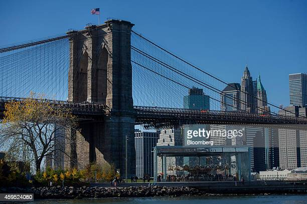 A US flag flies on top of the Brooklyn Bridge as seen from the DUMBO neighborhood in the Brooklyn borough of New York US on Saturday Nov 15 2014...