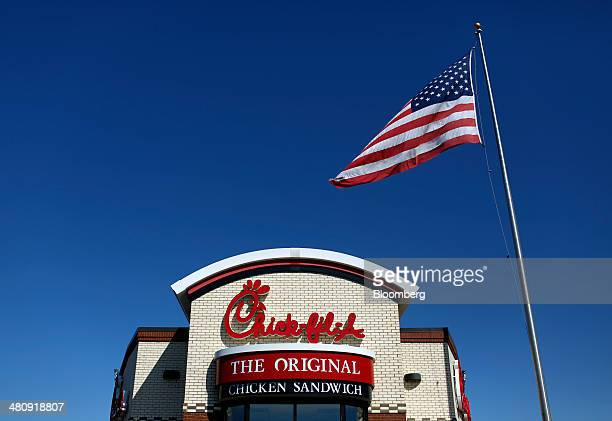 A US flag flies outside a ChickfilA Inc restaurant in Bowling Green Kentucky US on Tuesday Mar 25 2014 The US economy grew more rapidly in the fourth...