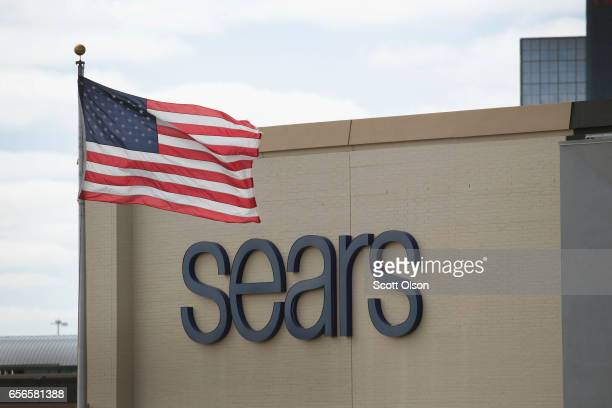 A flag flies outside a Sears retail store on March 22 2017 in Schaumburg Illinois Sears Holdings the parent of Kmart and Sears Roebuck Co said there...