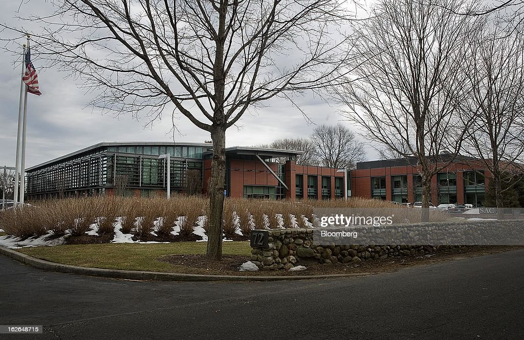 A U.S. flag flies outside of SAC Capital Advisors LP headquarters in Stamford, Connecticut, U.S., on Friday, Feb. 22, 2013. U.S. investigators have subpoenaed a 2011 deposition of SAC Capital Advisors LP founder Steven Cohen, whose sworn statements on insider-trading compliance may hurt him as he tries to persuade regulators not to file a lawsuit with the potential to shut his $14 billion firm. Photographer: Victor J. Blue/Bloomberg via Getty Images