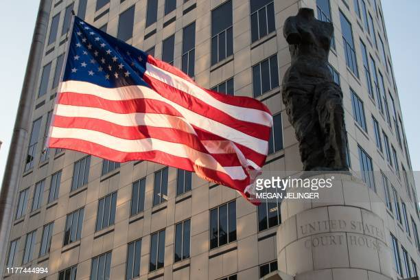 A US flag flies outside of the Carl B Stokes Federal Courthouse before a major drug trial between drug companies and two Cleveland counties Cuyahoga...