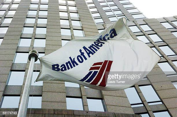 A flag flies outside the Bank of America Corporate Center June 30 2005 in downtown Charlotte North Carolina Bank of America which has its corporate...