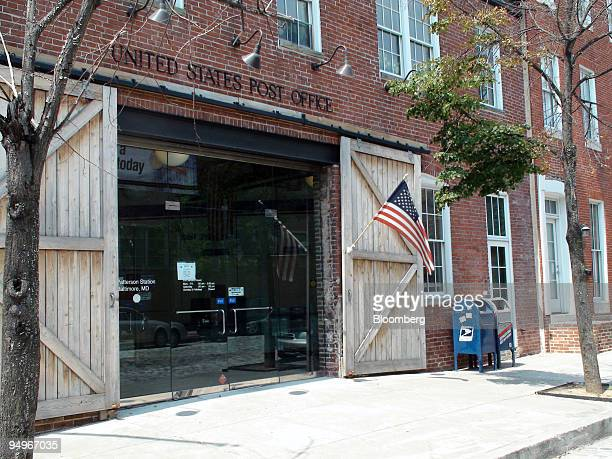 A flag flies outside the Fell's Point Post Office in Baltimore Maryland US on Aug 18 2009 Arthur Perschetz president of the Fells Point Residents...
