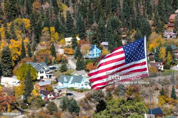 US Flag flies over small town Ouray Colorado