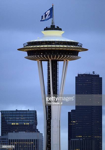 A flag flies over the Space Needle representing the '12th man' which honors the Seattle Seahawks fans prior to the NFC Championship Game between the...