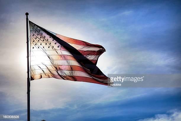 US Flag Fluttering in Backlit Blue Sky Symbolizing Government Transparency