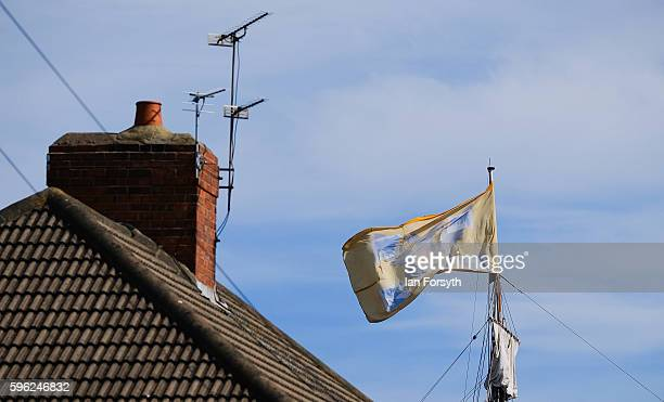 A flag flying from a mast of a tall ship rises over the rooftops during the North Sea Tall Ships Regatta on August 27 2016 in Blyth England The...