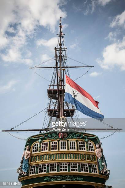 Flag flying from pirate ship against blue sky