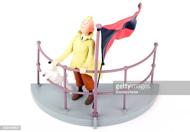 flag flying - tintin stock photos and pictures