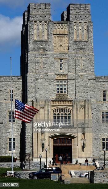 US flag flys at halfstaff outside Burrus Hall on the campus of Virginia Tech where 33 people were shot and killed a day earlier April 17 2007 in...