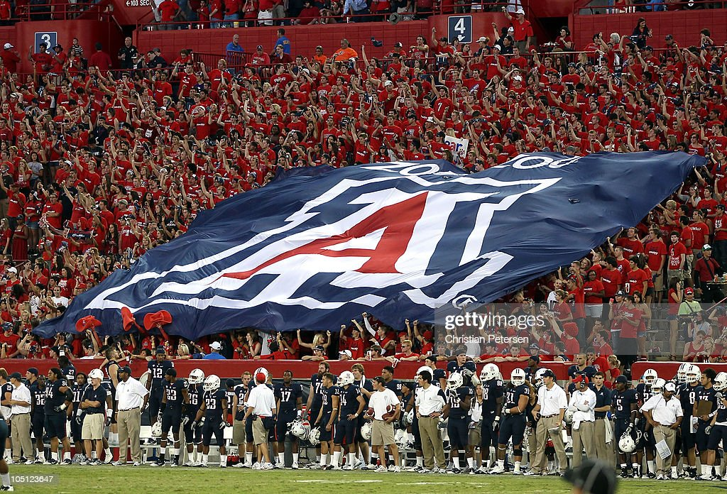 A flag for the Arizona Wildcats is held by fans during the college football game against the Oregon State Beavers at Arizona Stadium on October 9, 2010 in Tucson, Arizona. The Beavers defeated the Wildcats 29-27.