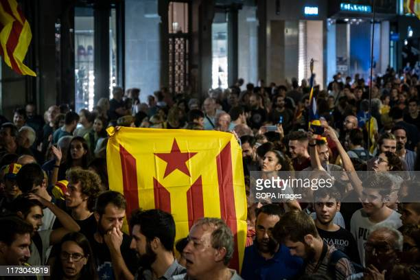 Flag for the independence of Catalonia is seen amidst protesters during the demonstration. Convened by the sovereign entity Assemble Nacional...