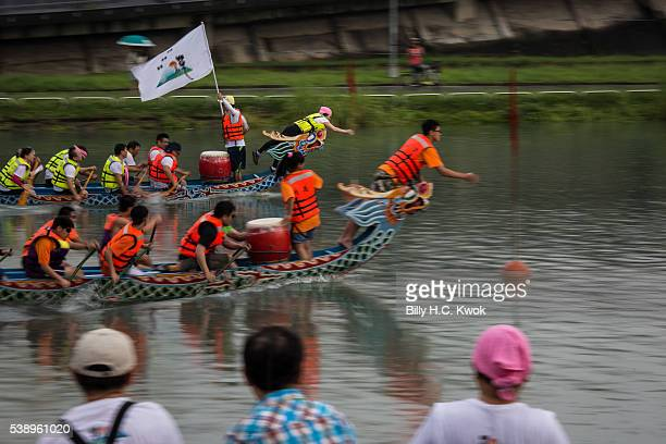 Flag grabbers compete to take the flag during the dragon boat race celebrating the Dragon Boat Festival on June 9 2016 in Taipei Taiwan Cities across...
