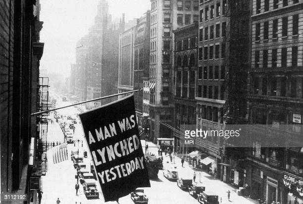 A flag hanging outside the headquarters of the NAACP bearing the words 'A Man was Lynched Yesterday'