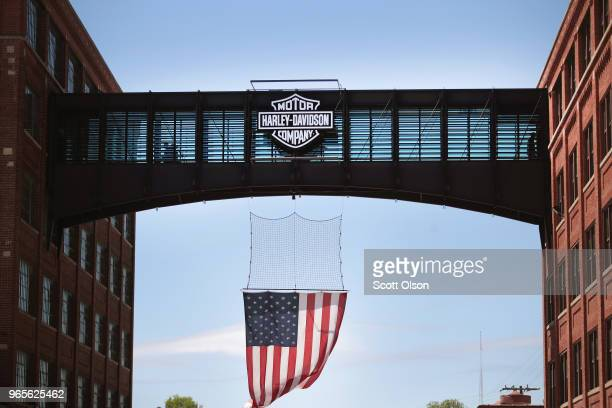 A flag hangs from a pedestrian bridge at the headquarters of iconic American motorcycle builder HarleyDavidson on June 1 2018 in Milwaukee Wisconsin...
