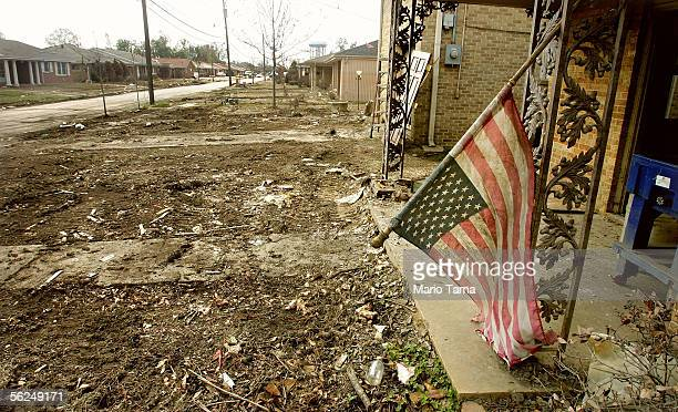 S flag hangs limply from a home in a heavily damaged section of East New Orleans November 21 2005 in New Orleans Louisiana The homes in the area are...