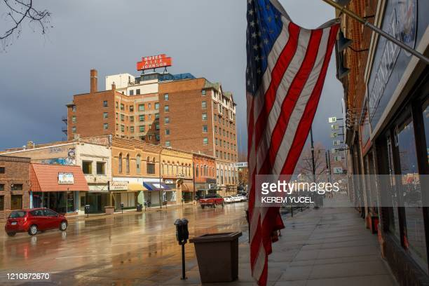 A US flag hangs on a street on April 23 2020 in Rapid City South Dakota South Dakota known for corn fields and cattle ranches is one of only five US...