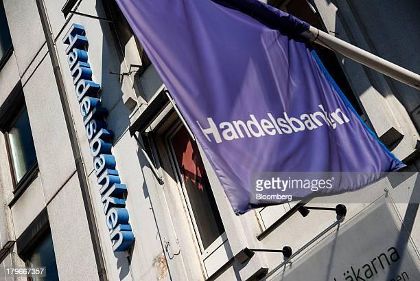 A flag hangs outside a Svenska Handelbanken AB bank branch in Gothenburg Sweden on Friday Sept 6 2013 Scandinavia's biggest banks have failed to curb...