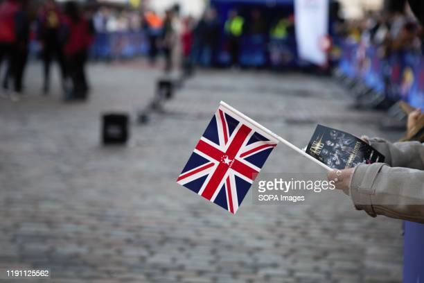 Flag held by a spectator during London's New Year's Day Parade 2020 Preview Show at Covent Garden Piazza.