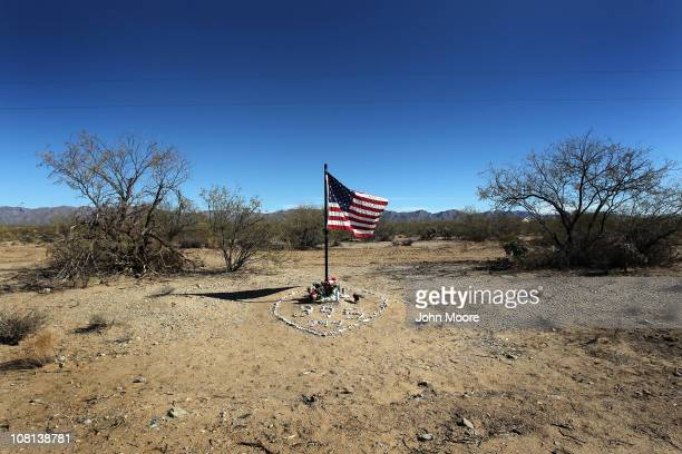 A flag honors slain US Border Patrol agent Michael Gallagher on January 18 2011 in the Tohono O'odham Nation Arizona Gallagher was killed by a drunk...