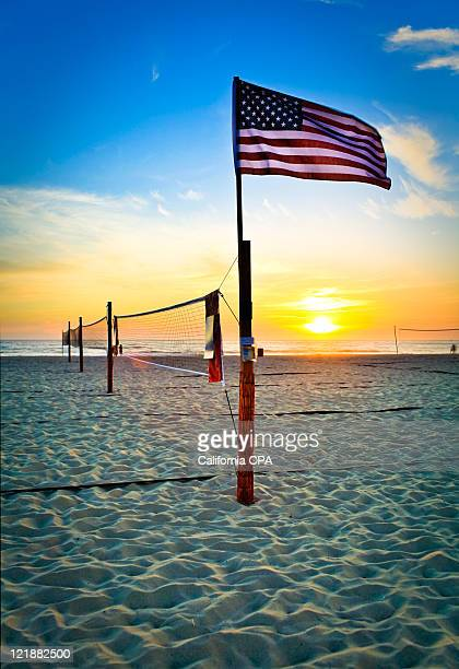 flag in beach - hermosa beach stock pictures, royalty-free photos & images