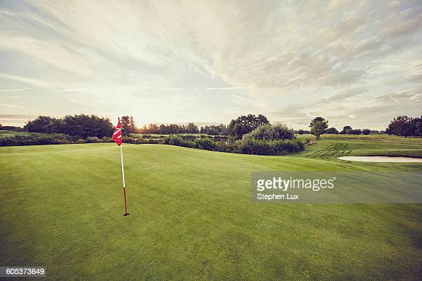 Flag in hole on golf course, Korschenbroich, Dusseldorf, Germany