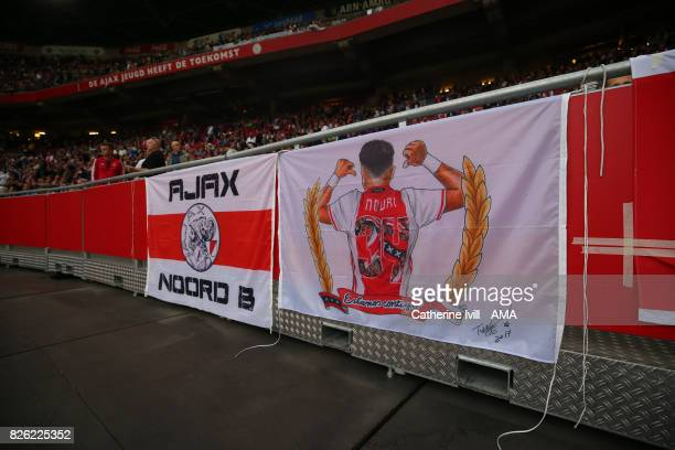 A flag in support of Abdelhak Nouri of Ajax during the UEFA Champions League Qualifying Third Round match between Ajax and OSC Nice at Amsterdam...