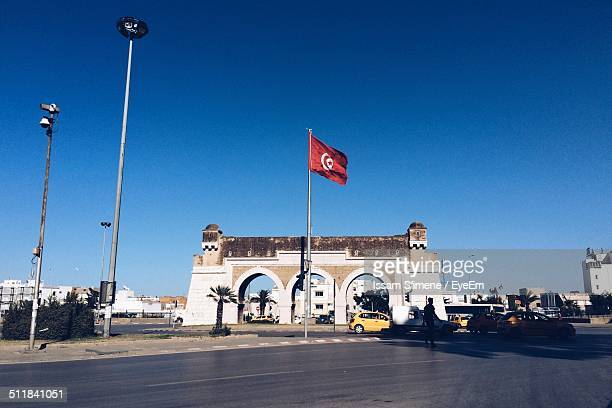 flag in the center of road - tunisia stock pictures, royalty-free photos & images