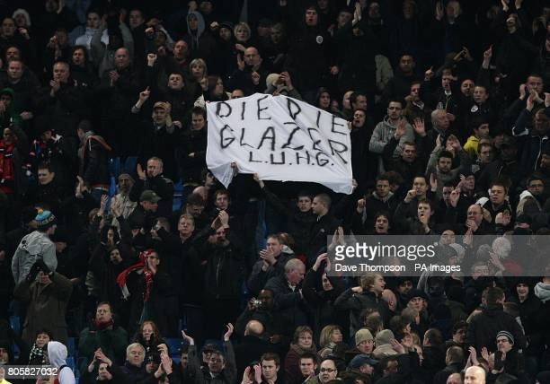 A flag in the stands that says 'DIE DIE GLAZER LUGH' which is held up by members of the 'Love United Hate Glazers' a Manchester United fan group
