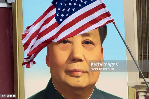 A US flag is displayed in front of the portrait of China's late communist leader Mao Zedong outside the Forbidden City in Beijing on November 8 2017...
