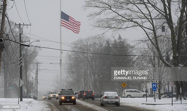A flag is flown at halfmast to mark the oneyear anniversary of Sandy Hook Elementary School shooting in Newtown Connecticut on December 14 2013 Adam...