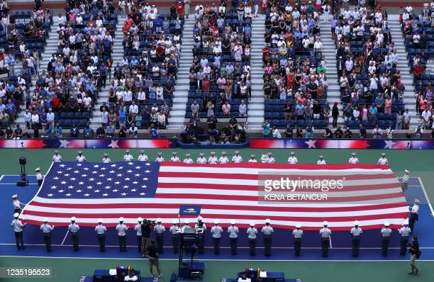 Flag is held on the court ahead of the 2021 US Open Tennis tournament women's final match between Britain's Emma Raducanu and Canada's Leylah...