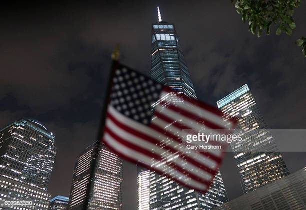 A flag is left in front of One World Trade Center at the national 9/11 Memorial in advance of the 15th anniversay of the 9/11 attacks on the World...