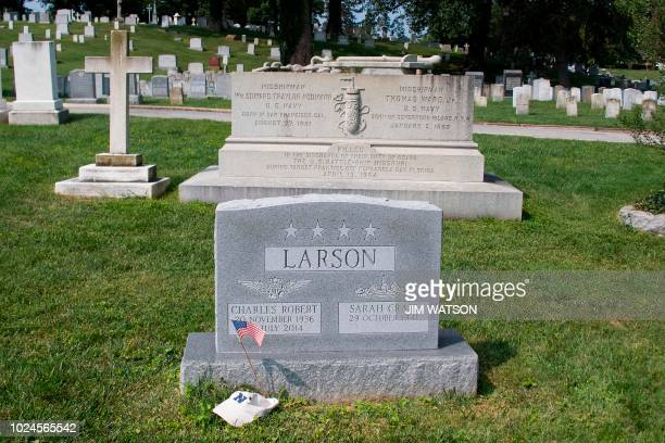A flag is placed at the base of the tombstone of US Navy admiral Charles 'Chuck' Larson at the US Naval Academy in Annapolis Maryland on August 24...