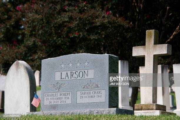 A flag is placed at the base of the tombstone of US Navy admiral Charles Chuck Larson at the US Naval Academy in Annapolis Maryland on August 24 near...