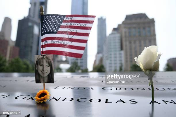 Flag is placed near a victim's name at the September 11 Memorial at Ground Zero on August 31, 2021 in New York City. New York City and much of the...