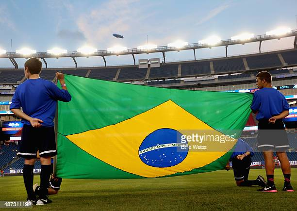 A flag is prepared before an international friendly between the United States and Brazil at Gillette Stadium on September 8 2015 in Foxboro...